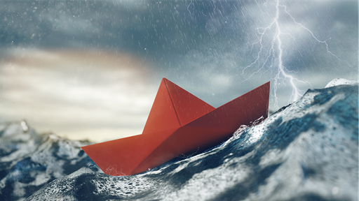 Paper Boat in Stormy Sea